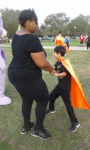 Kaleb dancing with Elisa Planellas at the Gift of Life's 2019 5K super run